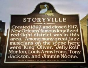 "Historic Marker for Storyville, New Orleans (Red Light District).  Sign reads: ""Created 1897 and closed 1917, New Orleans' famous legalized red-light district was in this area.  Among many great jazz musicians on the scene here were ""King"" Oliver, ""Jelly Roll"""" Morton, Louis Armstrong, Tony Jackson, and Jimmie Noone."""