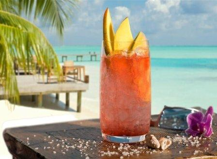 Beach with palm tree and cocktail